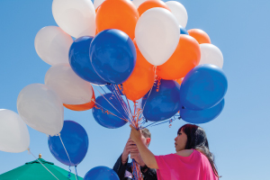 Pepperdine event with orange and blue balloons outside