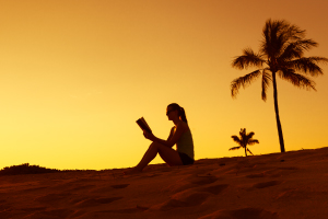 Graziadio student reading the Bible at the beach
