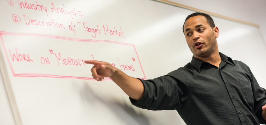 Alumni Keith Obilani teaching in classroom
