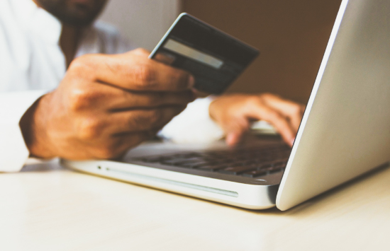 Person paying for services online with credit card