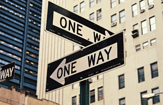 One way signs in busy city area