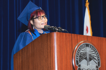 Minh Le speaking at commencement ceremony