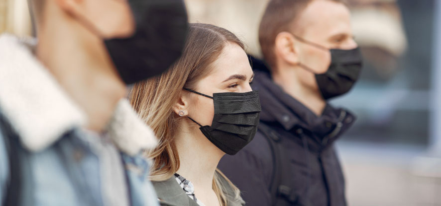 Students looking forward wearing face masks