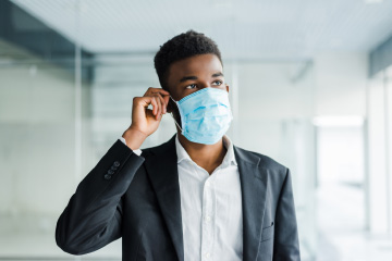 Business student wearing a face mask during the pandemic