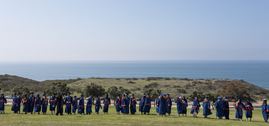 Students graduating outside at Pepperdine