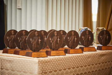 Line up of George Awards trophies