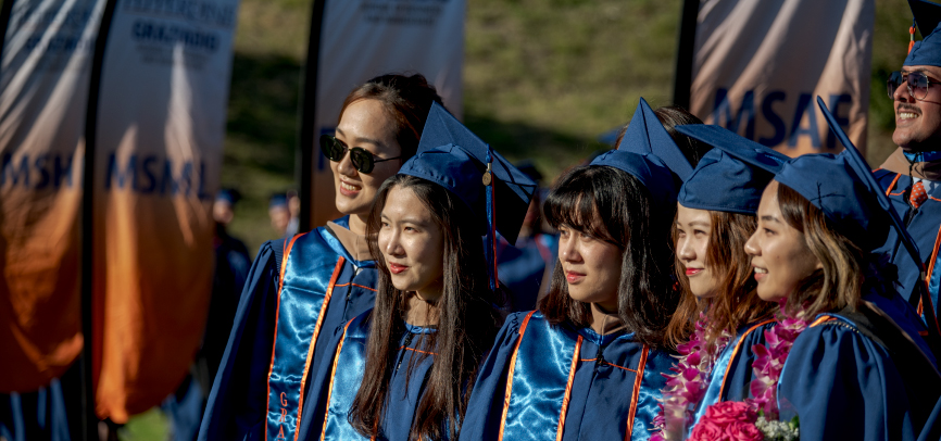 International students together at graduation ceremony at Drescher Campus