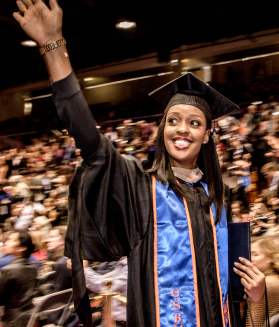 Graduating student waves during commencement - Pepperdine University