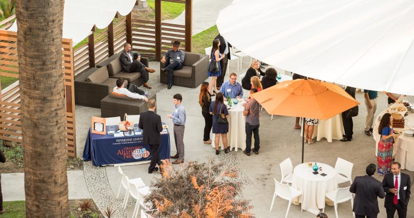 Group of Graziadio alumni networking at New Graduate and Alumni reception event in Long Beach
