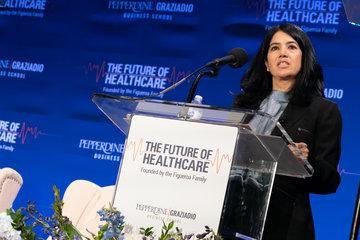 Panel speaker standing at the podium at the Future of Healthcare Symposium