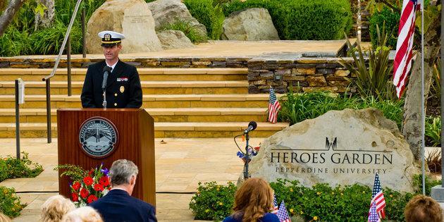 Image of veteran speaking at podium