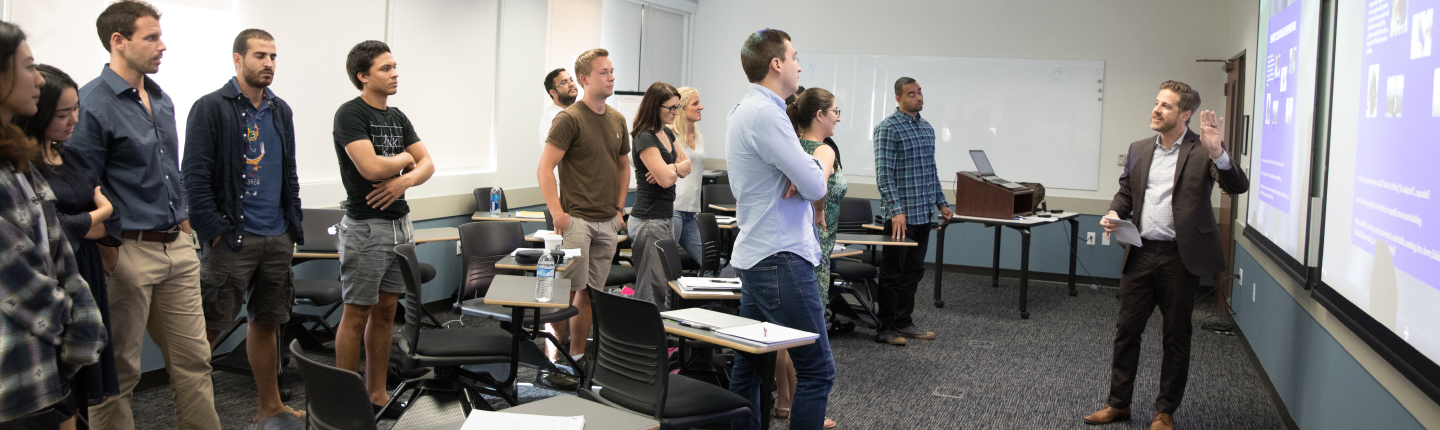 Masters of science students standing in classroom