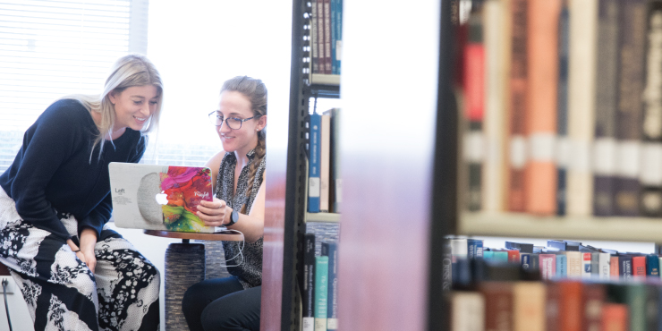 Two graziadio students studying in library