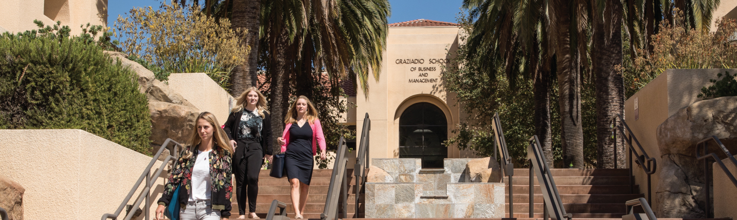 Students walking outside of the business school campus in Malibu