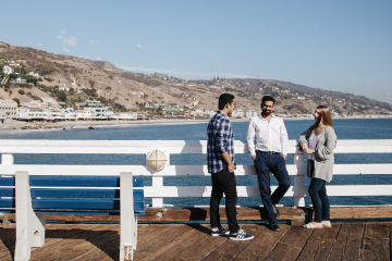 Full-Time MBA students standing on the Malibu Pier